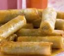 receptenvandaag Honingrolletjes gevuld met pistachenoten in een honingsaus